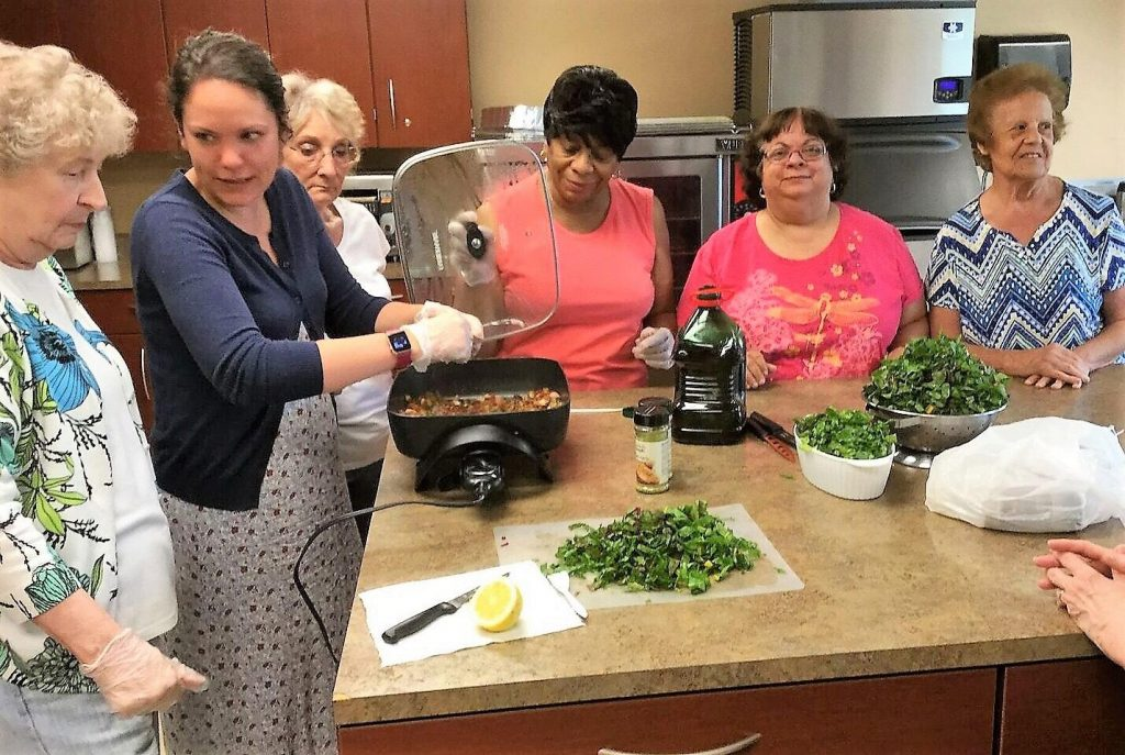 Brass City Harvest staff nutritionist Nichole Texeira, MPH, teaching a cooking and nutrition class.