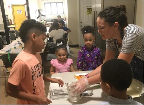 Brass City Harvest staff nutirtionist Nichole Texeira, MPH, teaches children about cooking and nutrition.